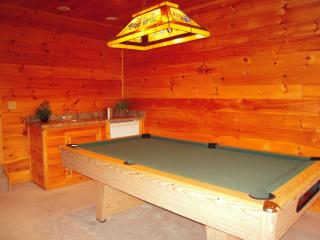 A large POOL TABLE in the downstairs Game Room with a convenient wetbar