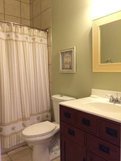 Jack n Jill bath with shower/tub combo 1st floor. between twin beds & bunk bed rooms.