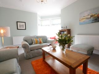Cosy feel, but light and warm sitting room with two sofas and two tub armchairs.