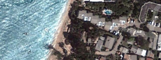 coloured photo from satellite showing condo complex - NB photo taken prior to beach restoration -