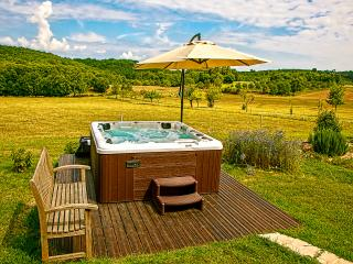 Relaxing in the Jacuzzi over looking the green Dordogne countryside