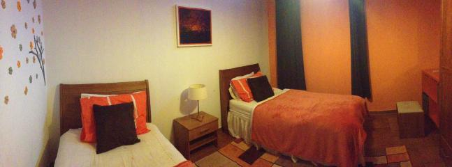 The orange bedroom.  Not ensuite, but has own shower room right outside.