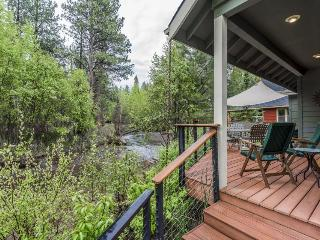 Modern, riverfront home w/ entertainment in a quiet, charming community