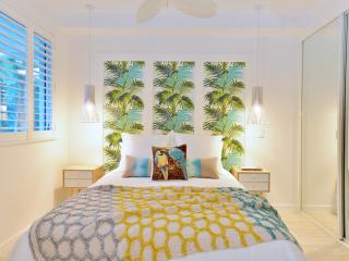 Stylish bedroom with plantation shutters