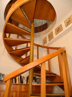 Spiral stairs connecting levels.