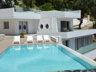 Villa ALGEOS as a cloud floating between clear blue sky and crystalline sea, Barbati