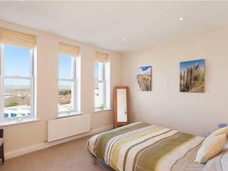 Main bedroom with views of the sea, estuary and golf course