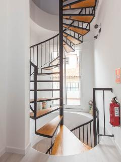 spiral staircase leads to each room and art studio on the top