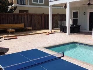 Sun, splash, or score points! This backyard has it all! Enjoy the sun, the pool, games and grill!