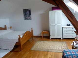 The bedroom has a 7 foot bed, bedside tables with lamps, wardrobe and chest of drawers.