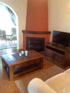 Colourful sitting area with wood burner, flat screen, dvd, etc... Also fun in winter!