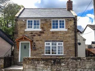 TY CERRIG, pet-friendly character cottage, woodburner, close to village pub, in