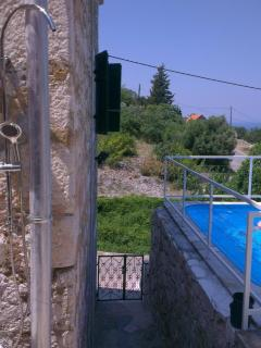 Stairs that lead from the property entrance to the secluded terasses and the pool
