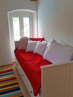Daily bed on the lower floor can be turned into double bed if necessary