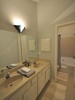 Master bath with shower/tub combo and double vanities