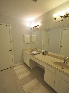 Bathroom 2 with double sinks and shower/tub combo
