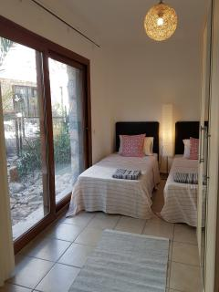 Twin bedroom with outside  palm & cactus garden   view