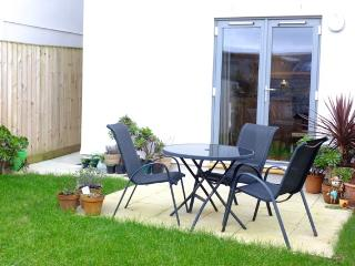 Private back garden, with seating for 4 adults.