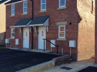 Front of house with ample parking for 2 cars