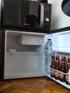 The microwave and the mini bar with some fresh drinks for my guest