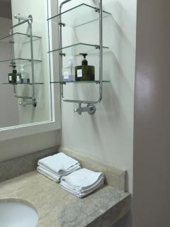 Toiletries and hot water in bathroom.