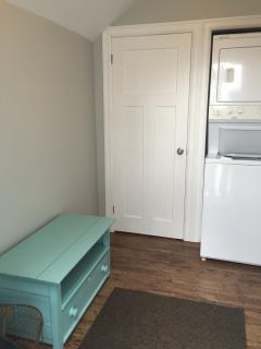 Roomy entryway with washer/dryer, seat, and closet .Outdoor clothesline on property.