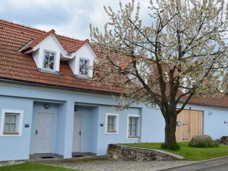 Front doors of Crab Apple Tree Lodge to left, Cherry Tree Lodge on right.  Cherry Tree in blossom!