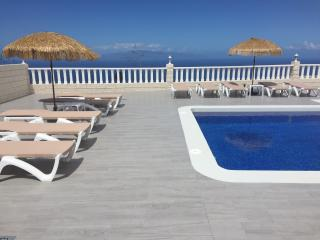 Sun Loungers & Shades surrounding the pool