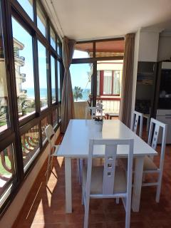 Dining table, exit to the balcony and the view.