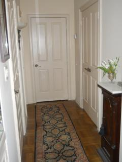 WIDE HALLWAY WITH DOUBLE DOORS TO MASTER SUITE