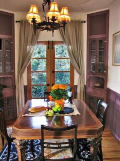 Dining room - table has extra leaves to accommodate elegant dinner parties.