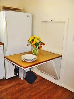 Original eat-in kitchen table (folds flat to wall) - great place to stage your dinner service.