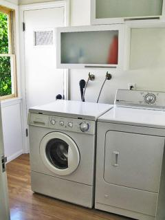 Light and bright laundry/utility room with iron & ironing board, supplies provided.