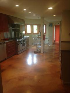 Custom kitchen with poured cement floor
