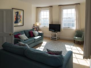 Comfortable and spacious sitting room with tv, dvd player and a selection of books; dvds and games