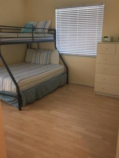 Kids room with a full / twin bunk bed.