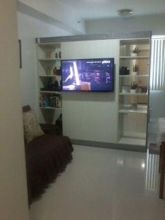 Living room: wide flat screen TV, DVD player and movies, cable TV channels and free wi-fi