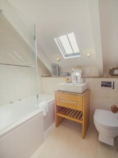 Bathroom with shower - hear the sound of the ocean from the window.