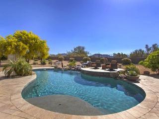 Scottsdale home with beautiful mountain views, close to shops, golf, and fine restaurants.
