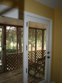 Private Screened Porch, adjacent to private parking space