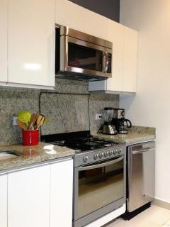 Modern refrigerator, gas range, dishwasher, microwave