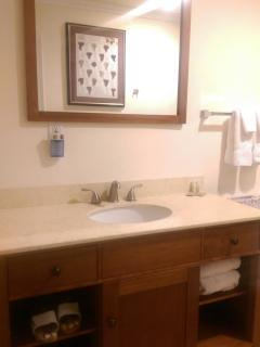 Bathroom with plenty of counter-space and fresh towels on demand.