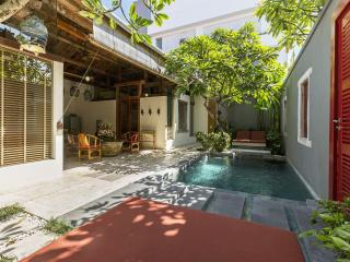 2 bedroom villa with natural stone swimming pool in private courtyard filled with frangipani trees.