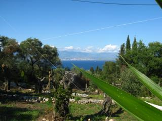 overlooking the gardens with amazing sea views and across the sea is albainia and the mountains