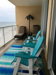 Spacious balcony with comfortable seating