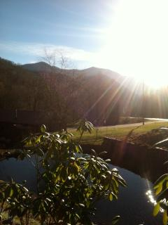 View from walkway to home as setting sun begins to dip below Smokey Mountains