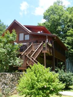 3 floor home, big deck, screened lanai porch, hot tub on lower porch, RV garage