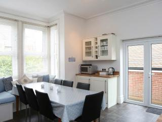 large sunny kitchen diner,seating 10, doors to garden