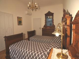 bedroom #1 with antique furniture