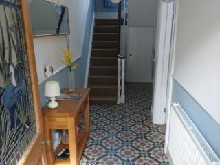 Entrance hall with tiled floor.